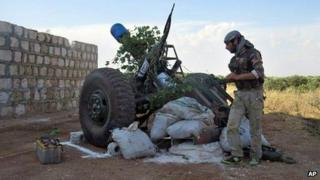 Syrian rebel firing shells made from gas cylinders in Idlib province