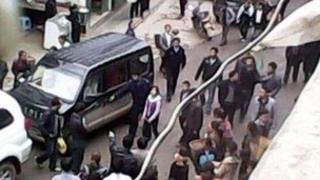 Chinese girl handcuffed for spilling drink on official's car (28 May)