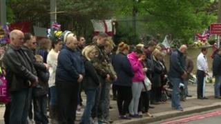 Members of the public observe a minute's silence in Woolwich