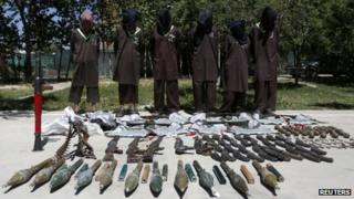 Insurgents suspected of being from the Haqqani network are presented to the media at the National Directorate of Security (NDS) headquarters in Kabul 30 May 2013
