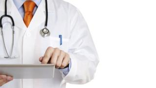 Doctor works on a tablet