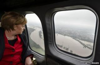 German Chancellor Angela Merkel surveys the Elbe flooding from an aircraft, 4 June