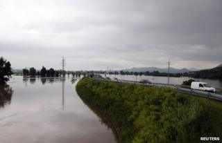 Traffic passes on a road surrounded by Elbe floodwater near Litomerice in the Czech Republic, 4 June