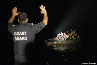 Coastguard signals to refugee boat