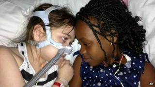 Sarah Murnaghan, left, lies in her hospital bed next to adopted sister Ella on the 100th day of her stay in Children's Hospital of Philadelphia. 30 May 2013,