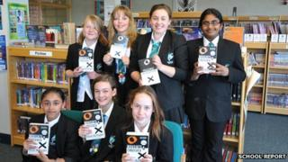 Pupils from Chorlton High School show off their books