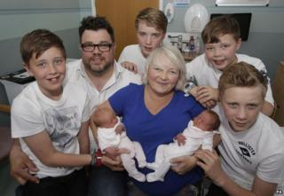 Karen Rodger who defied the odds by becoming pregnant with her third set of twins is pictured holding her newborns Rowan (left) and Isla (right) with with husband Colin Rodger (2nd left) and their sons left to right Finn, Lewis, Jude and Kyle at the Southern General Hospital in Glasgow.