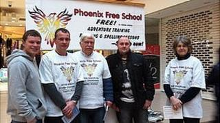 Phoenix team with leaflets