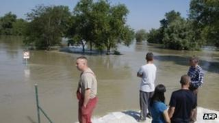 Locals survey flooded River Danube in Domos village, west of Budapest 08/06