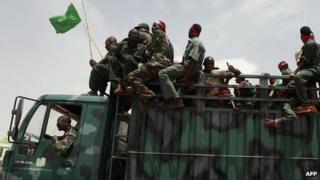 Sudanese soldiers in a truck on 24 July 2008