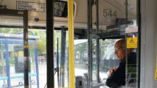 Bus driver giving advice at bus stops
