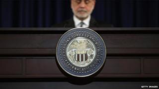 US Federal Reserve chairman Ben Bernanke behind a lectern