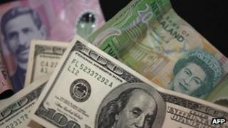 File photo: New Zealand and American currency
