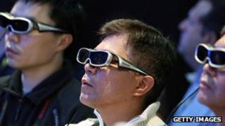 People watching 3D television