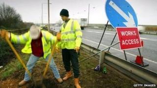 Workmen widening a motorway