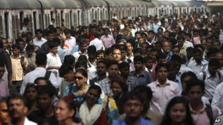 Commuters disembark from trains in Mumbai (file photo)