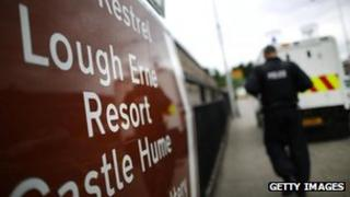 A policeman walks past a sign pointing to the Lough Erne Resort - location of the G8 summit