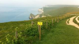 Coast path closure sign near Lulworth