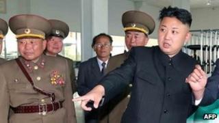 File photo: North Korean leader Kim Jong-un (centre) inspects the Songchongang net-weaving factory in South Hamgyong province, North Korea.