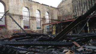 Pool building damaged by fire