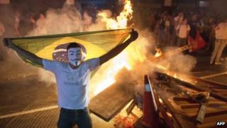 A masked Brazilian protester in Niteroi. Photo: 19 June 2013