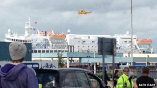 Helicopter hovering over ship