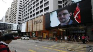 A TV screen shows a news report of Edward Snowden in Hong Kong. Photo: 22 June 2013