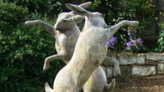 Dancing hares statue