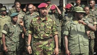 Brigadier Muhoozi Kainerugaba (C) with other officers on 16 August 2012