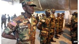 Liberian troops stand in rows before joining the current African-led International Support Mission to Mali, 20 June.