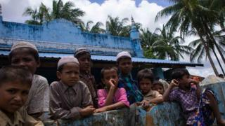 Rohingya children gather outside a mosque at Ah Nauk Pyin