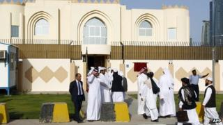 Guests arrive for the opening ceremony of the new Taliban political office in Doha on 18 June 2013