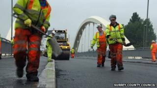 Workmen on Walton Bridge