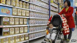 A Chinese mother looking at baby milk formula in a store in China