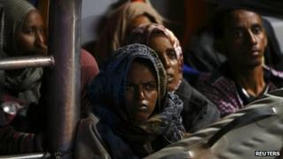 Migrants arrive in port in Malta after being rescued from a drifting boat, 4/7/2013