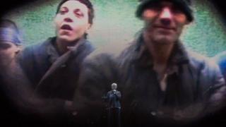 Elizabeth Fraser singing with giant screen