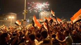 Egyptian celebrate in Tahir Square