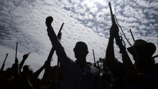 Armed vigilante group members take part in a demonstration of strength in a Guerrero village (20 June 2013)