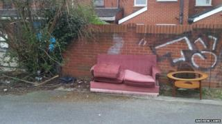 Discarded sofa and table in a road in Ipswich