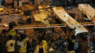 Chairs and tables are strewn across a street in Lahore following a bomb which killed at least three people