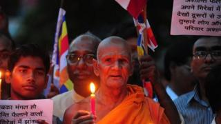 Buddhist monks in northern Indian town of Allahabad held a vigil against the blasts in Bodh Gaya