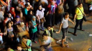 Male volunteers separate women from men in Tahrir Square on 5 July 2013
