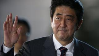 China media are criticising Japanese PM Shinzo Abe's military strategy