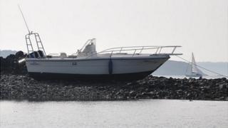 Cruiser Mon Ami on rocks off the coast of Guernsey
