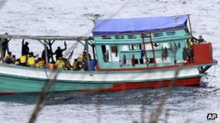"""File photo: a fishing boat carrying Vietnamese asylum seekers nears the shore of Australia""""s Christmas Island on 14 April 2013"""