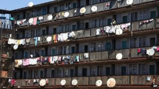An apartment block with satellite dishes in Harare, Zimbabwe