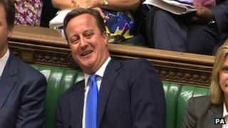 David Cameron smiles at prime minister's questions