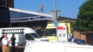 Mantas Badauskas on roof at Ipswich railway station