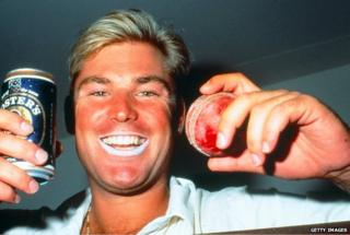 Shane Warne in 1994 with a tin of Foster's and a cricket ball