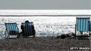 Sunbathers in Brighton on 20 July 2013